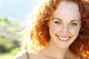 smiling redheaded woman