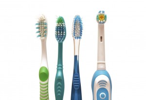Photo of manual and electric toothbrushes