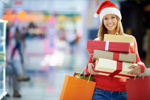 woman smiling holding presents